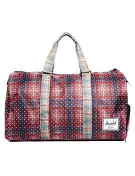 herschel-novel-holdall-in-plaid by asos