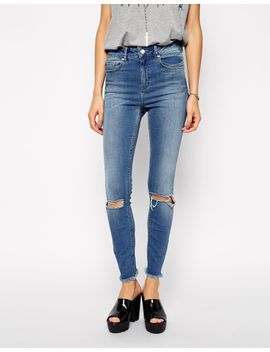 asos-ridley-ankle-grazer-jeans-in-gothenburg-mid-wash-with-busted-knees-and-raw-hem by asos-collection