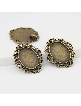 20pcs_lot-new-vintage-bronze-oval-cameo-filigree-cabochon-settings-18*25mm-metal-photo-jewelry-making-2559 by ali-express