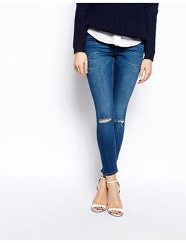asos-whitby-low-rise-skinny-ankle-grazer-jeans-in-faded-authentic-dark-wash-blue-with-ripped-knees by asos-collection