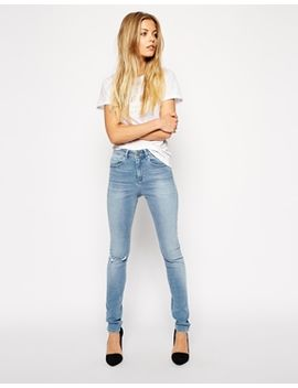 asos-ridley-skinny-jeans-in-real-light-wash-blue-with-ripped-knee by asos-collection