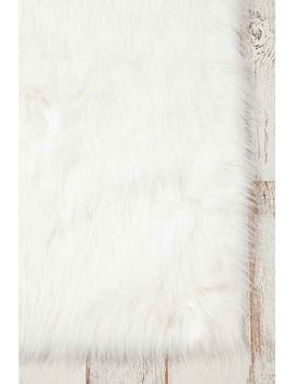 faux-sheep-skin-rug by urban-outfitters