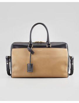 classic-two-tone-duffel-bag,-black_gold by saint-laurent