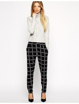asos-jersey-peg-pants-in-grid-check by asos-collection