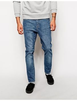 cheap-monday-dropped-tapered-fit-jeans-in-washed-blue by cheap-monday