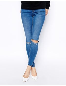 asos-ridley-skinny-jeans-in-busted-mid-wash-blue-with-busted-knees by asos-collection