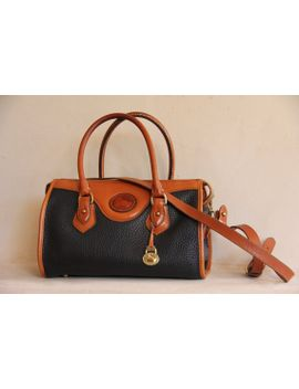 dooney-and-bourke-all-weather-leather-black-and-tan-tote-with-shoulder-strap by noondayshadows