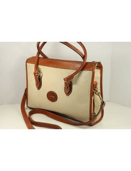 vintage-dooney-and-bourke-beige-color-leather-and-brown-leather-trim-with-hand-strap,-cross-body-shoulder-bag,-purse,-handbag by molohouse
