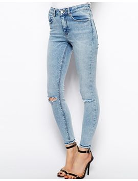 asos-ridley-high-waist-ultra-skinny-ankle-grazer-jeans-in-promise-light-wash-blue-with-let-down-hem-and-ripped-knees by asos