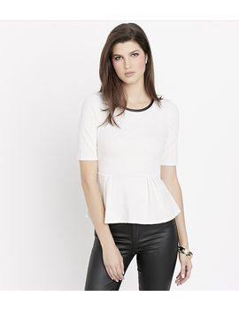 textured-peplum-top-with-faux-leather by dynamite