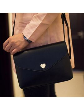 korean-style-womens-crossbody-bag-with-solid-color-and-heart-shape-design by sammy-dress