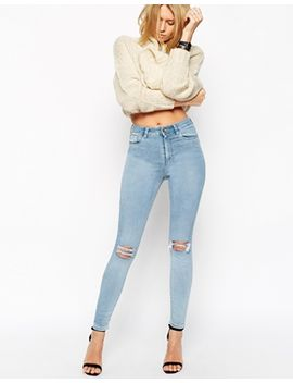 asos-ridley-skinny-ankle-grazer-jeans-in-petra-lightwash-blue-with-rip-and-destroy by asos-collection