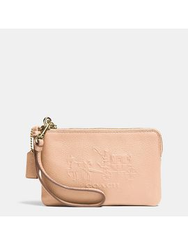 embossed by coach