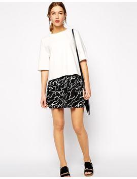 ganni-mini-skirt-in-swiggle-print by ganni