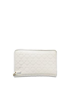 zip-around-travel-wallet by comme-des-garcons