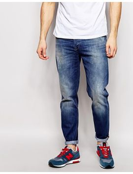 asos-relaxed-tapered-jeans-with-paint-and-abrasion-detail by asos