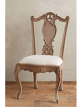 handcarved-tassel-armless-dining-chair by anthropologie