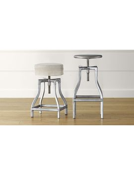 turner-gunmetal-adjustable-backless-bar-stools-and-linen-cushion by crate&barrel