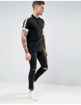 fred-perry-polo-shirt-with-sleeve-taped-sleeves-in-black-_-snow-white by fred-perry