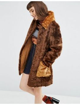 asos-a-line-coat-in-faux-fur-with-contrast-pockets by asos-collection