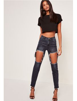 blue-riot-high-rise-open-thigh-rip-mom-jeans by missguided
