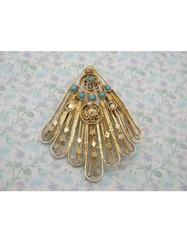 a-fine-large-hand-made-turkish-style-antique-jewelry-brooch-_-pendant-made-in-marked-silver-gilt-metal-and-set-with-turquoise-round-stones by vintagejewelleryetc