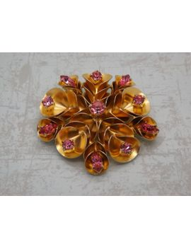 a-very-fine-large-round-flower-head-vintage-jewelry-brooch-in-goldtone-metal-and-set-with-sparkly-pink-multi-faceted-round-glass-stones by vintagejewelleryetc