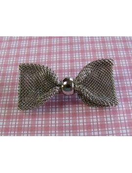 a-super-piece-of-designer-vintage-jewelry-in-the-form-of-a-brooch-made-in-a-large-bow-design-using-woven-silvertone-metal by vintagejewelleryetc