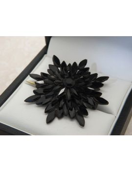 a-superb-victorian-black-glass-flower-head-design-antique-jewelry-brooch-made-in-a-hand-carved-black-glass-hand-set-petals-on-brass-mount by vintagejewelleryetc