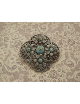 a-fine-bohemian-_-czech-vintage-jewelry-brooch-in-raised-filigree-openwork-silvertone-metal-set-with-shiny-cabochon-mottled-turquoise-stones by vintagejewelleryetc