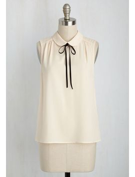 feedback-at-it-sleeveless-top-in-cream by modcloth