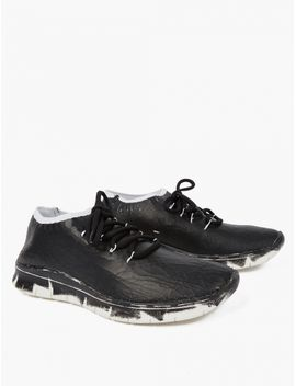 Black Painted Flyknit Sneakers by Maison Margiela
