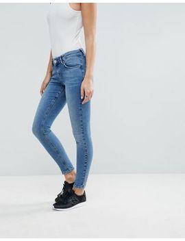 asos-design-lisbon-mid-rise-skinny-jeans-in-mid-vintage-wash-blue by asos-design