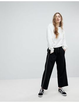 asos-cropped-wide-leg-joggers-with-spot-side-tape by asos-collection