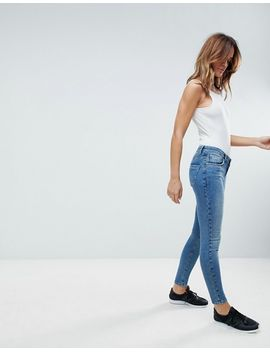 asos-design-lisbon-mid-rise-skinny-jeans-in-mid-vintage-wash-blue by asos-collection