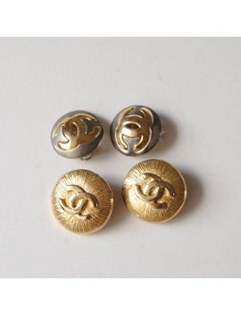 2-pairs-faux-chanel-clip-on-style-gold-and-silver-round-button-earrings-logo by etsy