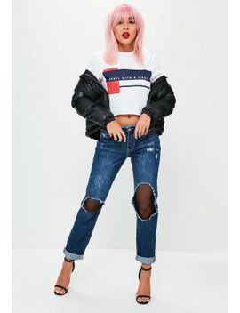 blue-low-rise-ripped-mesh-boyfriend-jeans by missguided